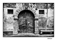 Old entrance (Artico7) Tags: door wood old windows blackandwhite bw italy history monochrome stone wall bench blackwhite ancient bars paint arch fuji cross arms number doorway 28 locked scraped biancoenero friuli housenumber pealing polcenigo xe1