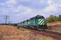 BN 7081, Alvord, TX. 9-08-1980 (jackdk) Tags: railroad train railway bn coal bnsf alvord burlingtonnorthern emd sd402 sd40 coaltrain emdsd402 coaldrag alvordtexas emdsd40
