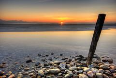 Sunset Solitude (alpenbild.de) Tags: sunset sun mountains alps reflection ice water seine bayern bavaria see evening abend wasser sonnenuntergang stones berge steine alpen eis sonne reflexion chiemsee hdr  chiemgau 50fav chieming  alpenbildde