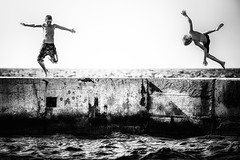 Jump!! - Summer Hits 2011 (Davide Gabino - StrolicFurlan) Tags: birthday boy sea summer sun white holiday black boys hope hawaii seaside jump mare estate dream friendly sole fires vacanza sogno speranza hawaiianair blackwhitephotos friendlyfires mygearandme