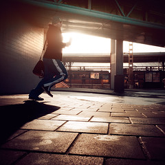 Catching the Train (Jeff Krol) Tags: life street city morning light sunlight man netherlands station train bag square fuji nederland streetphotography pedestrian running daily rush finepix fujifilm backlit groningen runner x10 jeffkrol fujix10 fujifilmfinepixx10