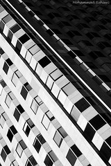 Chicago Heights (B&W) (Mohammad Rehawi | Evil Hard) Tags: blackandwhite bw white chicago abstract black canon buildings 550d chicagoheights