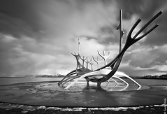 The Sun Voyager is sculpture by Jón Gunnar Árnason (1931 - 1989). Sun Voyager is a dreamboat, an ode to the sun. Intrinsically, it contains within itself the promise of undiscovered territory, a dream of hope, progress and freedom. (Gulli Vals) Tags: ocean city longexposure winter light sea sky blackandwhite bw sculpture sun white seascape black art nature water monochrome beautiful clouds canon walking landscape island coast iceland europe exposure north reykjavik coastline voyager nordic scandinavia northern maountains artic ísland foreground icelandic dreamboat gullivals