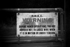 Warning Sign (RyanPrince) Tags: sea monochrome sign warning hampshire winch holgaesque hillhead 2011