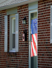 Flag (alankin) Tags: houses windows reflections geotagged doors suburban pennsylvania suburbia flags american redbrick manoa lawrenceroad windowreflections havertown phillysuburbs niknala 1000026 21sep2008 nikkorafvrzoom18200mmf3556gifed geo:lat=39982143 geo:lon=75321411