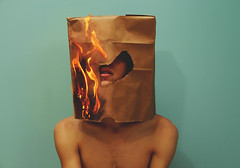 (Kyle.Thompson) Tags: lighting blue boy portrait guy wall self mouth bag paper fire head flames 365