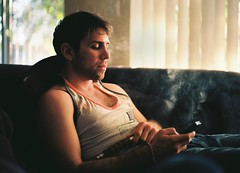 Zach on the Couch (Benjamin Disinger) Tags: california blue light sunset hairy brown sun white dice man art 120 mamiya film beach window beautiful look sunshine zach contrast analog dark hair relax 50mm evening haze afternoon tank adult natural ben angeles kodak top smoke low sunday young relaxing gritty dirty smoking couch jeans chilling lazy blinds denim medium format 100 benjamin 20 hazy rit oaks something chill sherman wifebeater hookah texting caucasian silverman 80mm ektar reddit 645j ranalog disinger