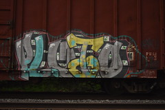 PLUTO (TheGraffitiHunters) Tags: street blue white black art car yellow train graffiti colorful paint box gray tracks spray pluto boxcar freight benched benching