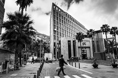 A Normal Day (Vittorio.DellErba) Tags: street city trees homes sky urban bw plants dog white black cars animal clouds square person lights movement nikon day shadows cloudy outdoor stones tenerife palaces reportage d7100