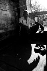 Light and life (Kals Pics) Tags: life light shadow portrait people blackandwhite bw india man art monochrome photography blackwhite nikon village pov perspective streetphotography wideangle rays 1855mm chennai colorless tamilnadu teashop cwc villagelife lightandlife d40 thiruvallur thirumazhisai tiruvallur kalspics chennaiweekendclickers