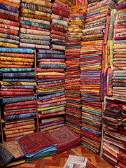 Rugs and Stuff (Hueystar) Tags: india shop material colourful rugs jaisalmer rajasthan throws gettyimagesindiaq4