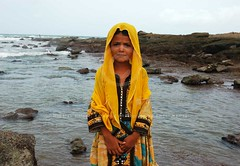 Portrait: Zikri young girl, Mubarak Village, Karachi (Ameer Hamza) Tags: pakistan people beach water girl hands village dress single karachi sindh wanderer mubarak zikri kpc attire ppa baloch zikris ameerhamzaphotography