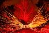 Butterfly effect (quornflake) Tags: longexposure red orange lightpainting man tree night stars weird surrey fisheye lighttrails trippy farnham startrails littlepond digitallightwand