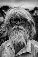 India (luca marella) Tags: street travel portrait people bw hairy india man eye film beard glasses blackwhite luca poor pb bn e eyeglasses bianco nero analogic marella marellaluca