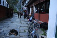 Having lunch in a small village while mountain biking on a Multi sport treking Mountain biking rafting kayaking trip in Nepal