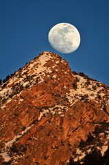 Moon balanced on Mount Olympus (houstonryan) Tags: sunset sky moon lens photography rising mirror march utah photographer mt ryan 5 houston olympus full mount photograph moonrise mm 500 rise 500mm lunar 2012 nearly houstonryan