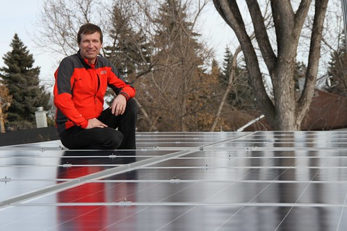 Karl Kovacs on the roof with his 24-panel solar electric system that will produce almost as much electricity as he consumes. - 2