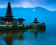 Bratan Lake Temple 3 [Explored March 15th] (Raji Vathyam) Tags: bali lake mountains water beautiful rain clouds canon dark indonesia lens landscape scenery shade kit 1855mm beratan lakeberatan