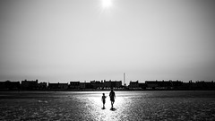 Sandymount, Dublin street photography - Dublin, Ireland (Giuseppe Milo (www.pixael.com)) Tags: street city ireland light sea urban blackandwhite bw dublin sun white man black monochrome backlight contrast geotagged photography photo europe fuji child candid father streetphotography son faceless fujifilm ie onsale x70 sandymount fujix fujix70