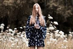Black Bird - 01 (Johnnie Macarroni) Tags: flowers portrait woman spring