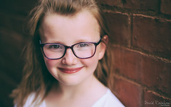 Lily (David Raynham) Tags: uk portrait england colour art love girl smile glasses 3d nikon lily bokeh f14 daughter 8 sigma naturallight pop sharp portraiture d750 fullframe fx shallowdof sigma50mmf14art