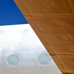 Wing and Body (studioferullo) Tags: old blue light arizona sky brown abstract texture lines metal museum contrast plane airplane outdoors gold design flying colorful pretty pattern bright tucson outdoor space aircraft air flight wing sunny bluesky line diagonal pima vehicle minimalism