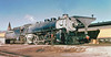 Union Pacific MT-1 class 4-8-2 Alco built mountain type steam locomotive # 7857, is seen leading a passenger train while at the station in Cheyenne, Wyoming 10-15-1955 (alcomike43) Tags: old railroad mountain color classic up station train vintage photo track platform engine rail slide historic depot unionpacific locomotive steamengine 482 steamlocomotive mt1 alco passengertrain boxpok cheyennewyoming switchstand vanderbilttender