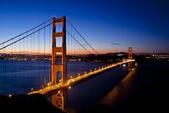 Golden Gate Bridge (Leighton Wallis) Tags: sanfrancisco california road birthday ca usa tower cars water sunrise dawn bay traffic unitedstatesofamerica pylon goldengatebridge cables lighttrails suspensionbridge marinheadlands sutrotower 75thanniversary ggnpc11