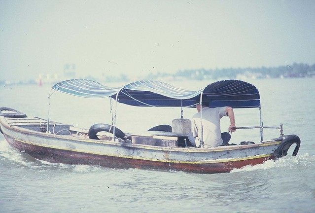 Man in Covered Boat