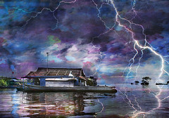 Houseboat in a Storm (Explored!) (D'ArcyG) Tags: blue sea storm water asian boat cambodia purple magenta houseboat explore lightning