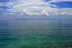 let clouds merge with oceans ! - explore (Teo Morabito) Tags: ocean blue white clouds curve