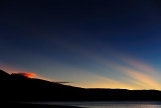 Buddha-rays over Manasarovar at sunset, Tibet