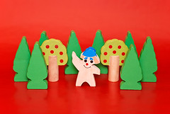 toy (Viadomina) Tags: man ecology forest garden toys happy peace orchard harmony environment isolated redbackground