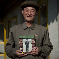 HOMME MONTRANT LA PHOTO DE SON FILS PARTI A L ARMEE A JUNG PYONG RI VILLAGE, COREE DU NORD (Eric Lafforgue Photography) Tags: people man color colour male tourism smile square person asia joy happiness korea tourists communism asie coree sourire bonheur personne couleur humanbeing joie communisme hosting homme northkorea tourisme dprk accueil carre touristes lookingatcamera colorpicture waistup squarepicture loger democraticpeoplesrepublicofkorea accueillir etrehumain coreedunord rpdc regardantlobjectif northhamgyongprovince republiquepopulairedemocratiquedecoree cadragealataille myongchoncounty jungpyongrivillage imagecaree