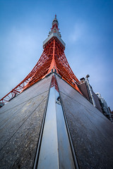Looking Up Tokyo Tower (ErikFromCanada) Tags: city travel blue sky orange reflection tower monument lines japan vertical metal stone architecture clouds japanese reflecting tokyo triangle famous wideangle tokyotower sight iconic ultrawide travelasia a7r
