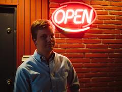 Nick (BurlapZack) Tags: portrait bar flickr neon open meetup bokeh availablelight handheld neonsign divebar dallastx pack01 arlingtontx panasonicleicadgsummilux25mmf14 vscofilm olympusomdem5markii milosbar