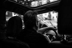 The Driver (TheKrippi) Tags: street city travel people blackandwhite bw man berlin car blackwhite driving cab taxi inthecar driver rushhour traveling lowkey