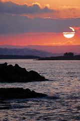 Cretan Sunset- Chania, Crete (Flortography) Tags: ocean travel light sky orange sun colors rock rouge island lumix photography photo europe foto tide shoreline magenta eu professional greece crete fotografia cretan