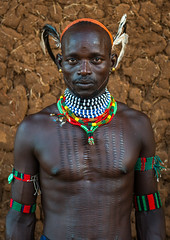 Maze whipper with scarifications on the chest to indicate he killed a man, Omo valley, Turmi, Ethiopia (Eric Lafforgue) Tags: africa shirtless portrait people haircut color men vertical outdoors photography necklace day adult african feather culture tribal maze blackpeople strong omovalley strength tradition ethiopia tribe ethnic hairstyle whipper scarification oneperson hamer confidence whipping headwear hornofafrica ethnology omo eastafrica abyssinia tribesman realpeople blackskin lookingatcamera onemanonly waistup turmi africanethnicity 1people indigenousculture ethnicgroup bulljumping blackethnicity ethiopianethnicity ethio161596