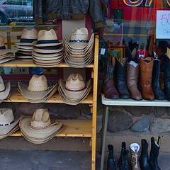 Outfitters (MPnormaleye) Tags: arizona window retail stone wall rural 35mm square town store cowboy boots rustic hats shelf jacket footwear utata western