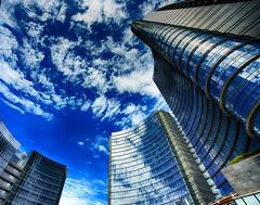 Buongiorno Milano (thescourse) Tags: sky milan skyline clouds skyscraper canon blu milano canondslr sigma1530 canoniani canonitalia canoneos5dmkii eos5dmkii pellitower