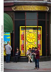 Dolce & Gabbana And Cell Phones (jwvraets) Tags: london harrods store people street cellphones shopwindow dolcegabbana yellow opensource rawtherapee gimp nikon d7100 nikkor18105vr