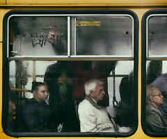 """Goldfinger"". (Tomasz Aulich) Tags: street city people woman man colour window water glass rain yellow hair glasses nikon tram poland streetphoto d urnan"