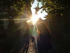 Enlightment (BonniesBeautifulWorld) Tags: street light people sun sunlight tree cobblestone cobbles contrejour