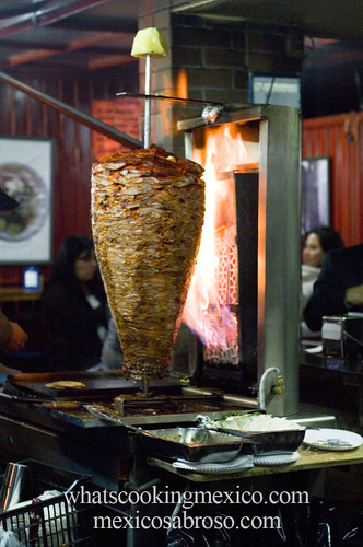 "Trompo<br /><span style=""font-size:0.8em;"">Read more about it here: <a href=""http://whatscookingmexico.com/2012/02/13/the-anatomy-of-a-taco/"" rel=""nofollow"">whatscookingmexico.com/2012/02/13/the-anatomy-of-a-taco/</a></span> • <a style=""font-size:0.8em;"" href=""http://www.flickr.com/photos/7515640@N06/6870229411/"" target=""_blank"">View on Flickr</a>"