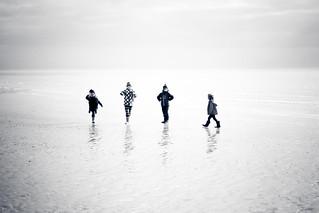 Four on the beach.