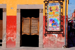 Colorful bar in San Miguel (sioux.106) Tags: world street city travel flowers autumn light mountains art history fall beautiful sign miguel festival horizontal stone wall gardens bar de mexico photography dawn town wooden ancient nikon san colorful pretty moments artist gallery photographer village shot gorgeous colonial peach culture parks photographers images tourist historic cobble galleries doorway artists writers sanmigueldeallende sanmiguel painters retirement allende retire cobbelstone sierramadremountains