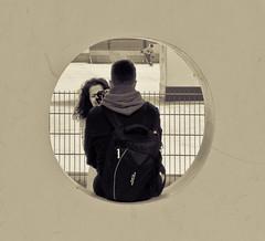 The portraitist. (Bas Tadema) Tags: street boy blackandwhite bw woman white black ice amsterdam pose museumplein iamsterdam photographer child o mother kind portraiture round backpack rink portret zwart wit moeder ijsbaan vrouw zoon straat vence portraitist jongen hekwerk fotograaf rondje straatfotografie geposeerd streetphotographing rugtas
