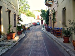 Narrow street (CameliaTWU) Tags: restaurant athens greece sidewalk pottedplants afternoonsun narrowstreet chiars