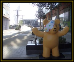 Salford Quays 13.Pudsey Bear's Welcome. jpg (Margaret Edge the bee girl) Tags: bridge sun yellow architecture modern buildings manchester outdoors model shadows salfordquays bbc bandage pudseybear